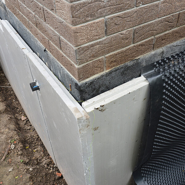foundation insulation and damp proofing in problem corner area. house basement, foundation insulation details with waterproofing and damp proof membranes